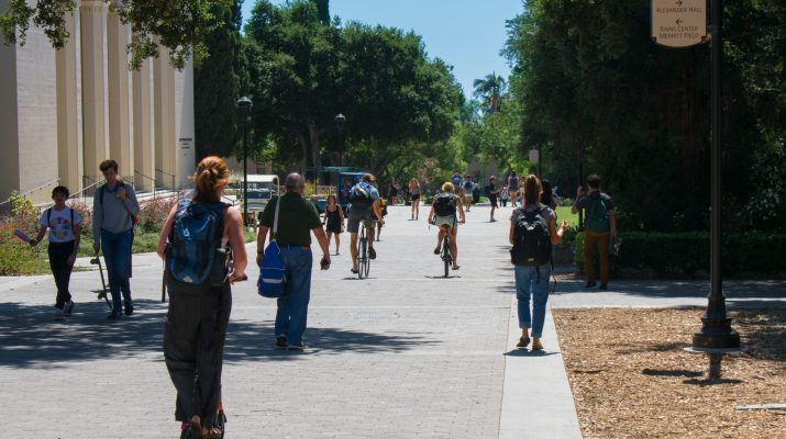 students walking on the pathway in front of Big Bridges Auditorium