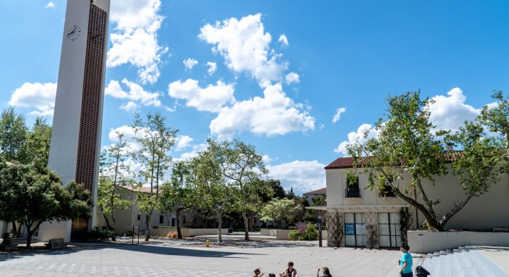 The Pomona College clock tower and Walker Hall on Bixby Plaza as viewed from outside Frary Dining Hall.