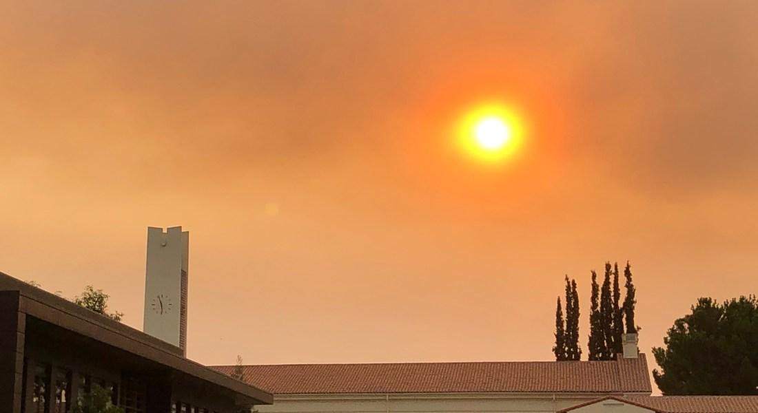 Smoky sky with orange colored sun