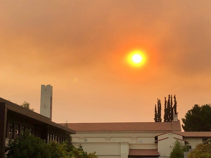Smoky sky with orange colored sun