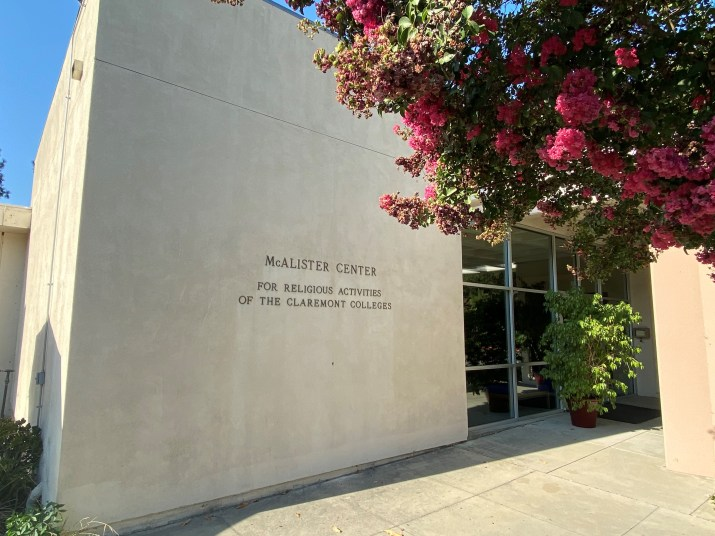 "A building has a sign that says ""McAlister Center for Religious Activities of the Claremont Colleges""."