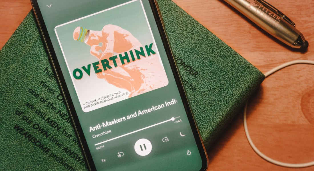 """A phone open to a podcast screen that says """"Overthink."""""""