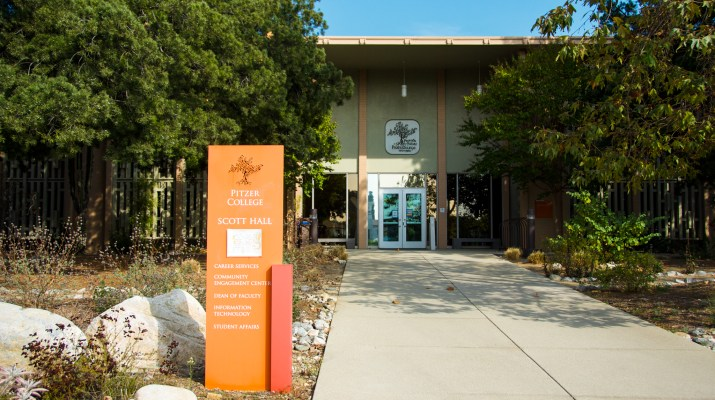 A sign for Pitzer College's Scott Hall outside of Scott Hall.