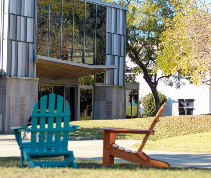 Two chairs sit on Pitzer College's lawn