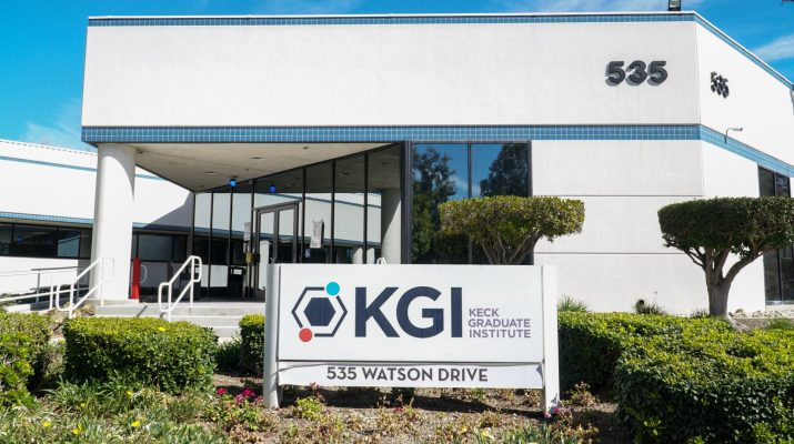 A large white building with a sign that reads KGI