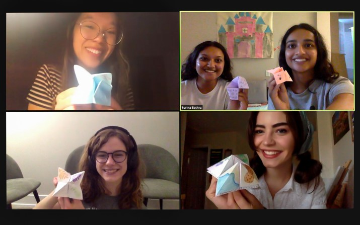 Five students on Zoom hold up homemade fortune tellers.