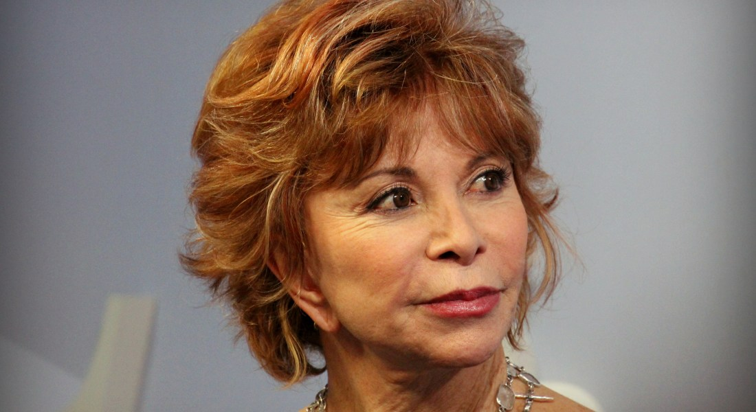Author Isabel Allende looks to the right.