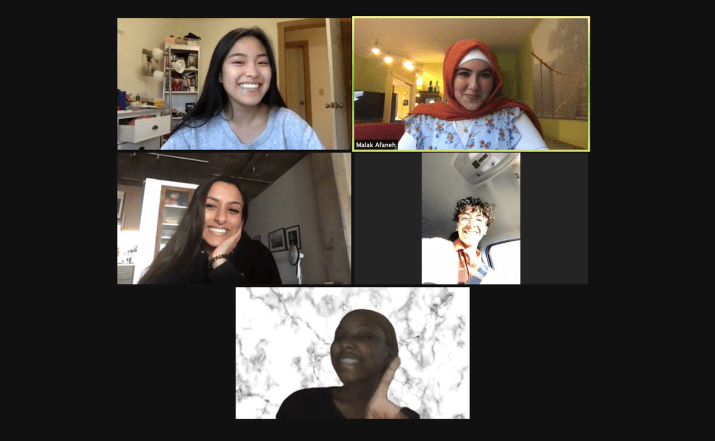 Five peope sit on a zoom call.