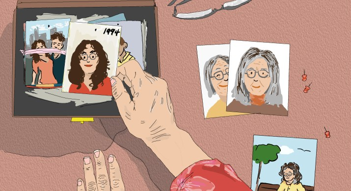 An elderly woman putting away old photos of her younger self