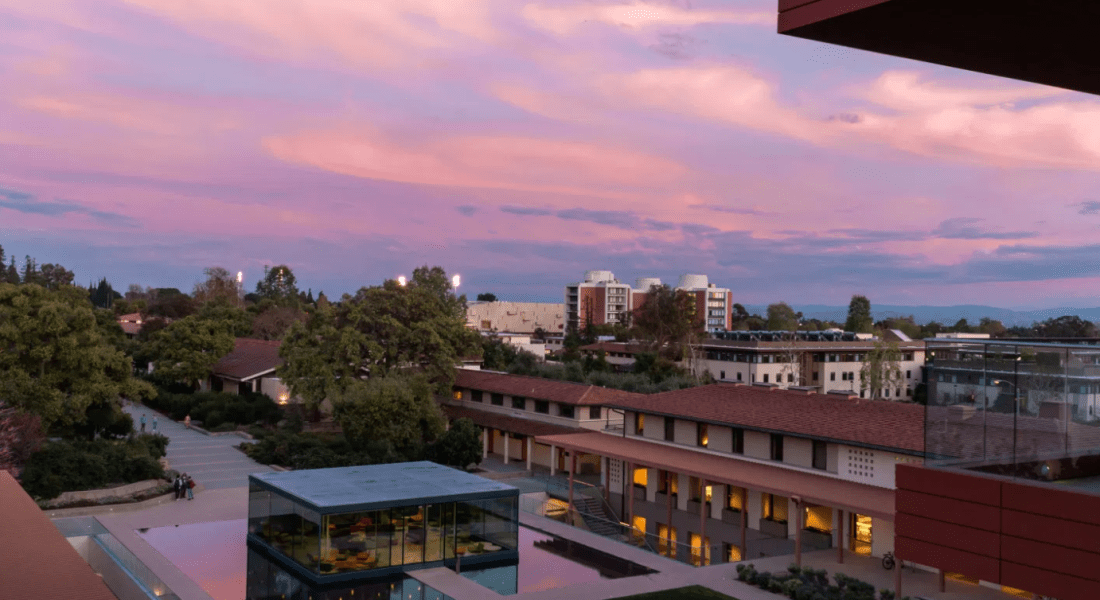 CMC buildings stand in the foreground against a purple sky