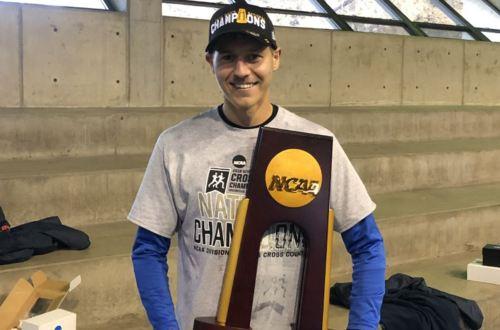 jordan carpenter holds an NCAA championship trophy