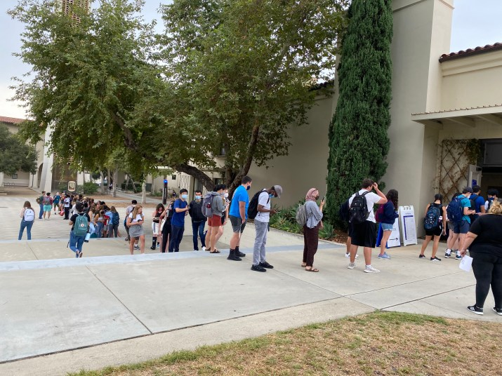 Students line up outside Walker Hall for COVID-19 testing.