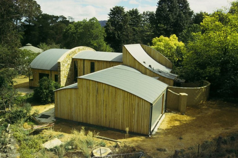 Piallago House - multiple curve steel roofs - vertical timber cladding