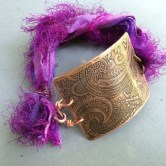 Etched copper cuff bracelet with purple sari silk closure accents