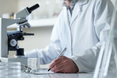 Scientist conducting mixed-mode research in a lab.