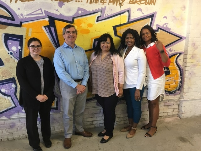 TTi Team Standing in front of a Graffiti Wall
