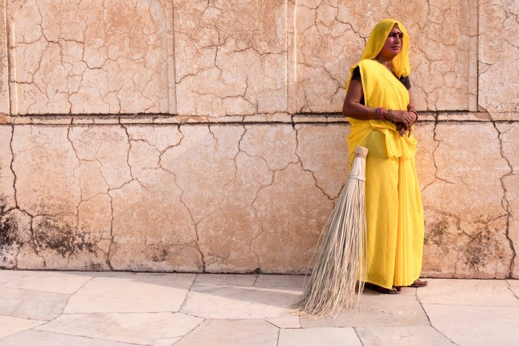 Woman in Yellow with Broom at Amber Fort - Jaipur, India - Copyright 2016 Ralph Velasco