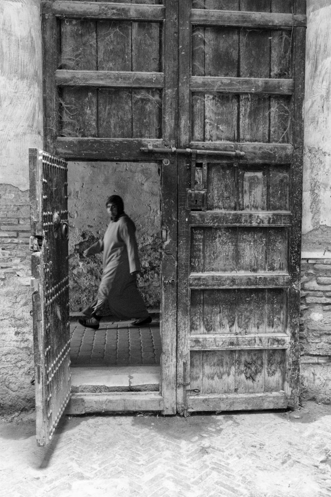 Woman Walking by Doorway at Caravan Serai in BW - Fés, Morocco - Copyright 2017 Ralph Velasco
