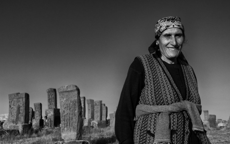 Woman in Cross Stones from Low BW - Noratus, Armenia - Copyright 2018 Ralph Velasco
