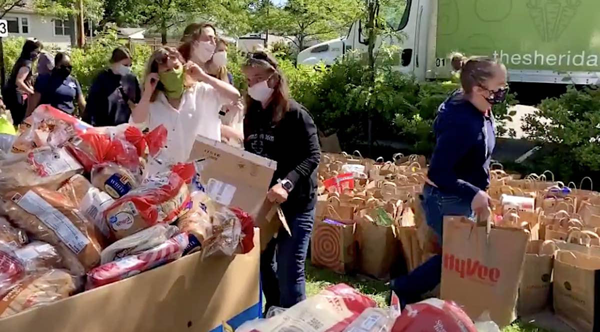 people processing donated food