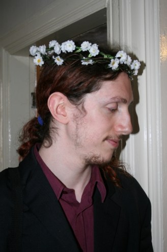 Ray, on his wedding day, wearing a flower crown
