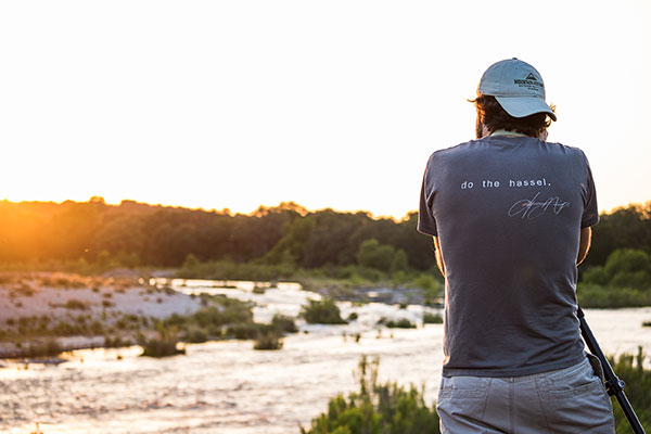 Jerod Foster taking photos of an early morning sunrise on the Junction trip this past summer. Photo curtesy of Dylan Lowery.