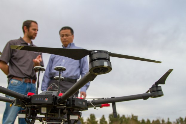 [Left to Right] Joey Young Ph. D., and Wenxuan Guo Ph. D., converse over the drone's flight stratagy for their upcoming research, funded by the United States Golf Association.