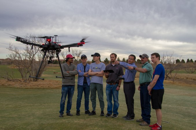 [Left to Right] Abir Raihan, Yazhou Sun, Zhe Lin, Joey Young Ph. D., Wenxuan Guo Ph. D., Rodnie Bermea and John Bennett look on as the research drone hovers over the Rawls Golf Course at Texas Tech. The research will also be conducted at the Amarillo Country Club.