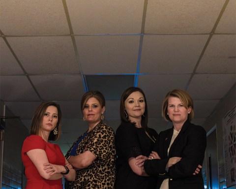 4 female professors standing in hallway