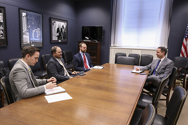 Photo of John Duff meeting with congressional staffers in Washington, D.C.