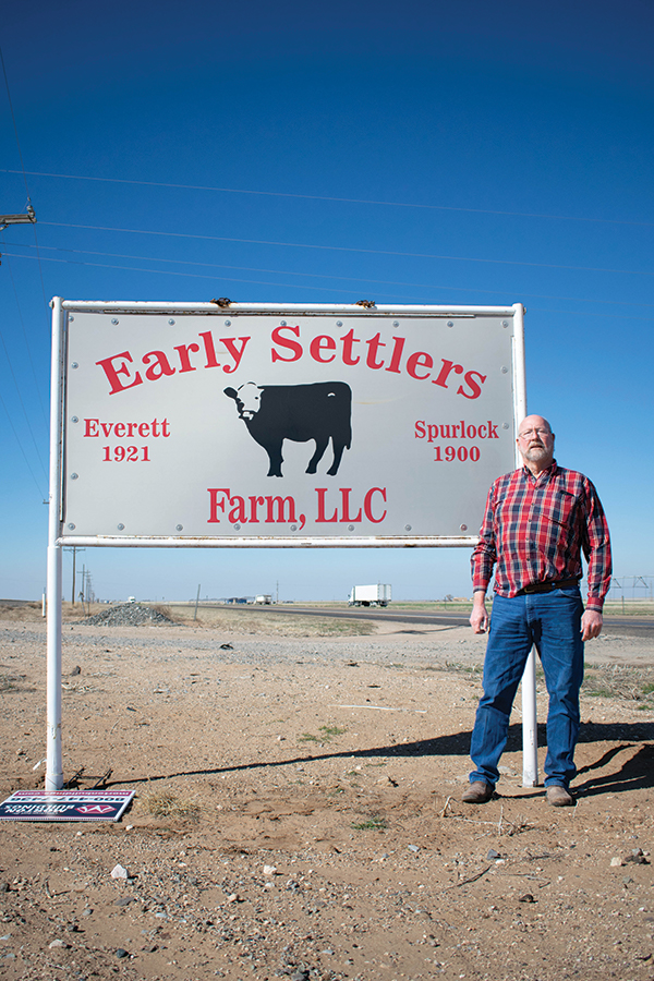 Spurlock stands at the sign for the feed yard.