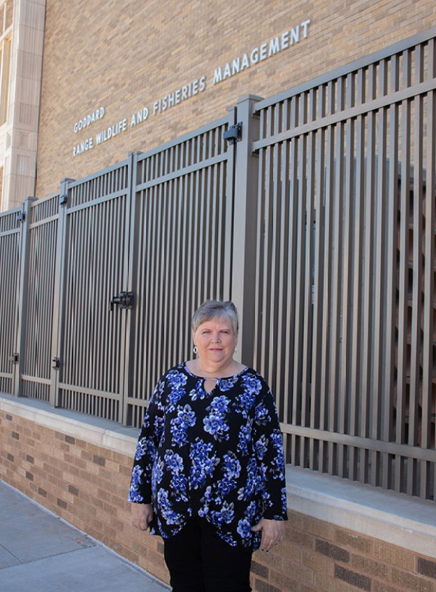 Picture of Kay Arellano standing outside of Goddard.