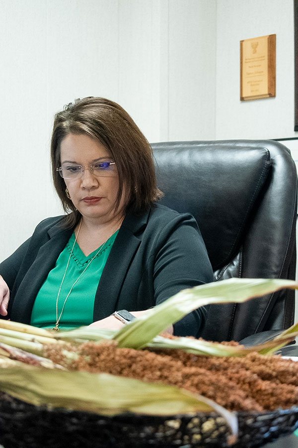 Norma Ritz Johnson sits at her desk tending to paper work.