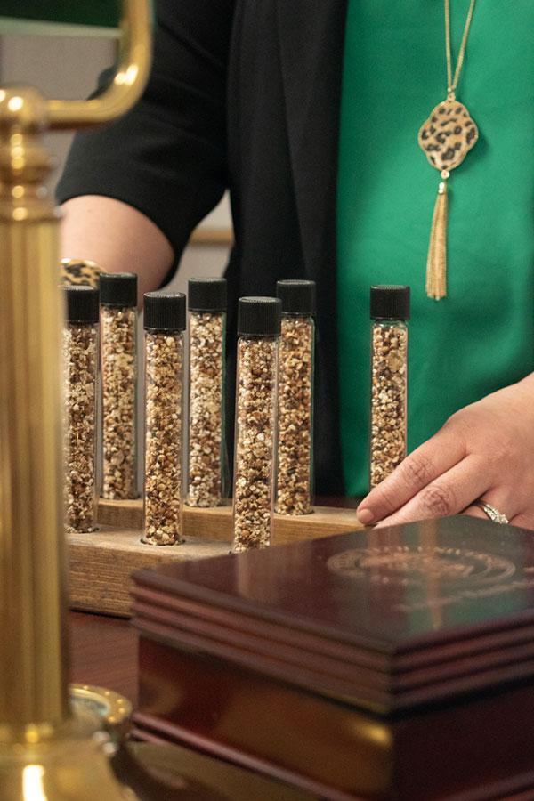 Sorghum samples sit on Norma Ritz Johnsons desk.