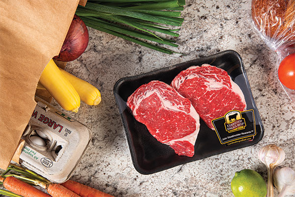 Certified Angus Beef packaged ribeyes at home.
