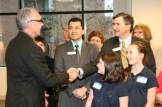 Mayor Lou Ogden shakes hand of Ryan Miller