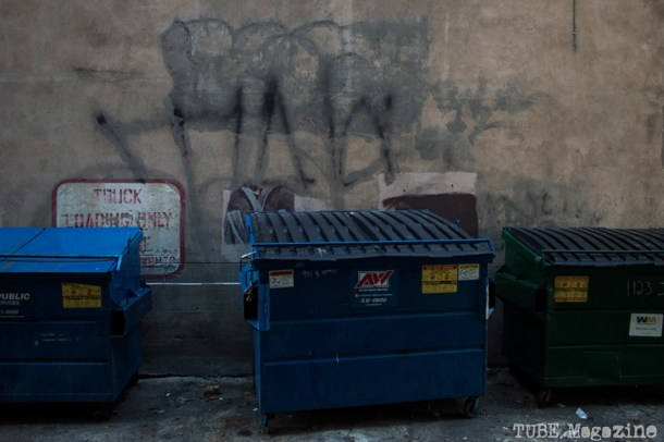 Layers of half-removed graffiti adorn the walls of an alleyway off of J Street. Photo M.Hershenow. 2014.