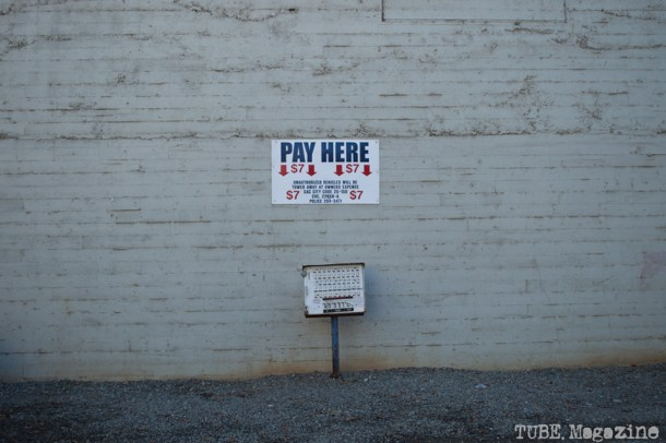 The parking machine of a gravel public lot on 7th Street. Photo M.Hershenow. 2014.