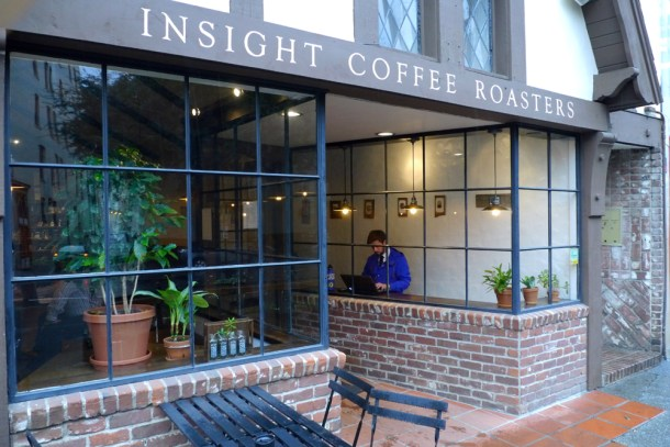 """Passersby get a quick peak at Logan Fessler's """"No Past, No Future"""" exhibit at Insight Coffee Roasters in downtown Sacramento"""