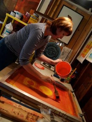 Asbestos Press owner and artist Laura Matranga works on a print in her Sacramento studio.