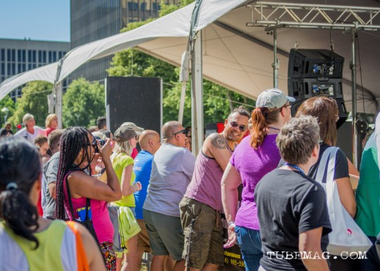 Krishna Teresi photographing a friend while watching Belinda Carlisle perform at Sac Pride 2015, Photo Sarah Elliott