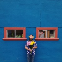 Boy With Flowers by Laura DeAngelis