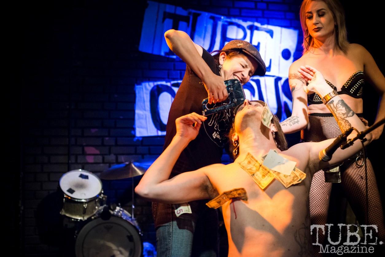 Naomi Lucchesi stapling money to The Displayed Labors Sideshow. TUBE. Circus, Blue Lamp, Sacramento, May 2016. Photo Melissa Uroff