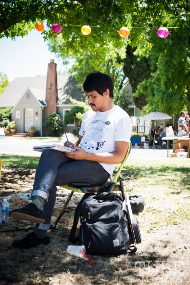 Waylon Horner drawing at the Crocker Block by Block Party in District 5, July 9, Sacramento CA. Photo Melissa Uroff