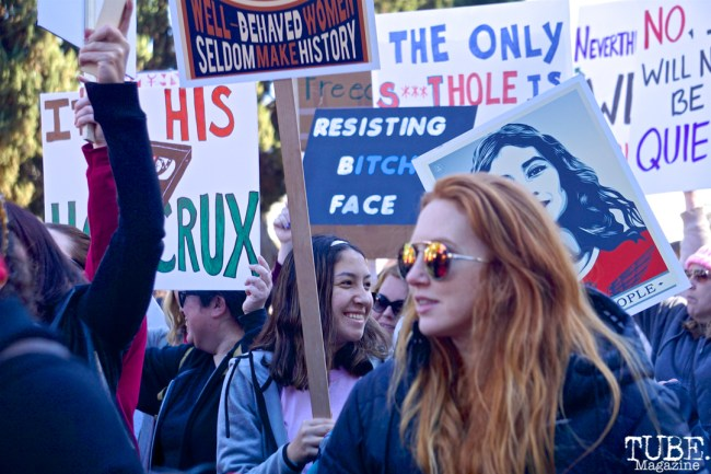 Katie Cox and Zoe Maggio with the Faces in the Crowd along the Women's March, Sacramento CA. January 2018. Photo Joey Miller