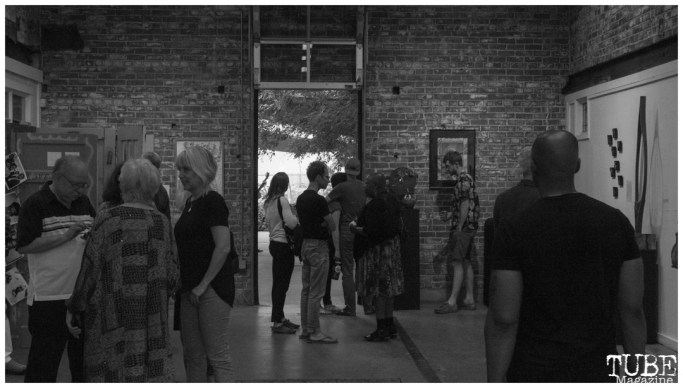 Onlookers gather at The Brickhouse Gallery & Art Complex in Sacramento CA. May 4th, 2018. Photo Benz Doctolero