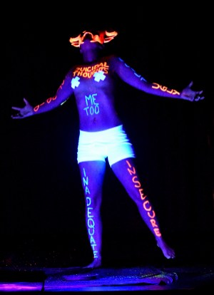 Mr. Siracha performing under black light