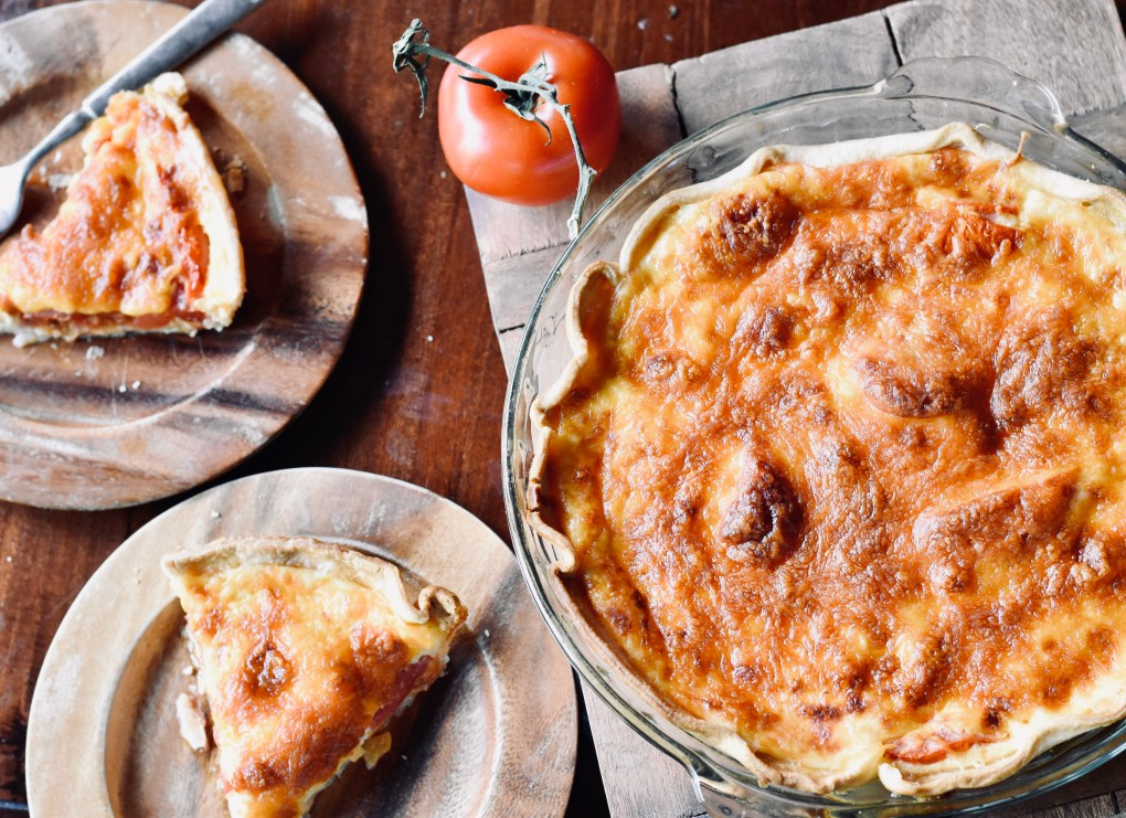 Tomato pies looking delicious on a wooden table