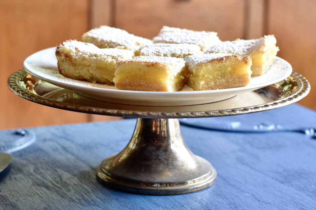 A silver plate of lemon bars