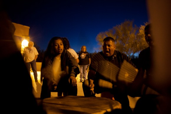 Members of the Tohono O'odham's drum group, Four Winds, began a chant at the plaza in Sells, signaling the start of the vigil organized by Tohono O'odham Hemajkam Rights group for the lives affected by Border Patrol.